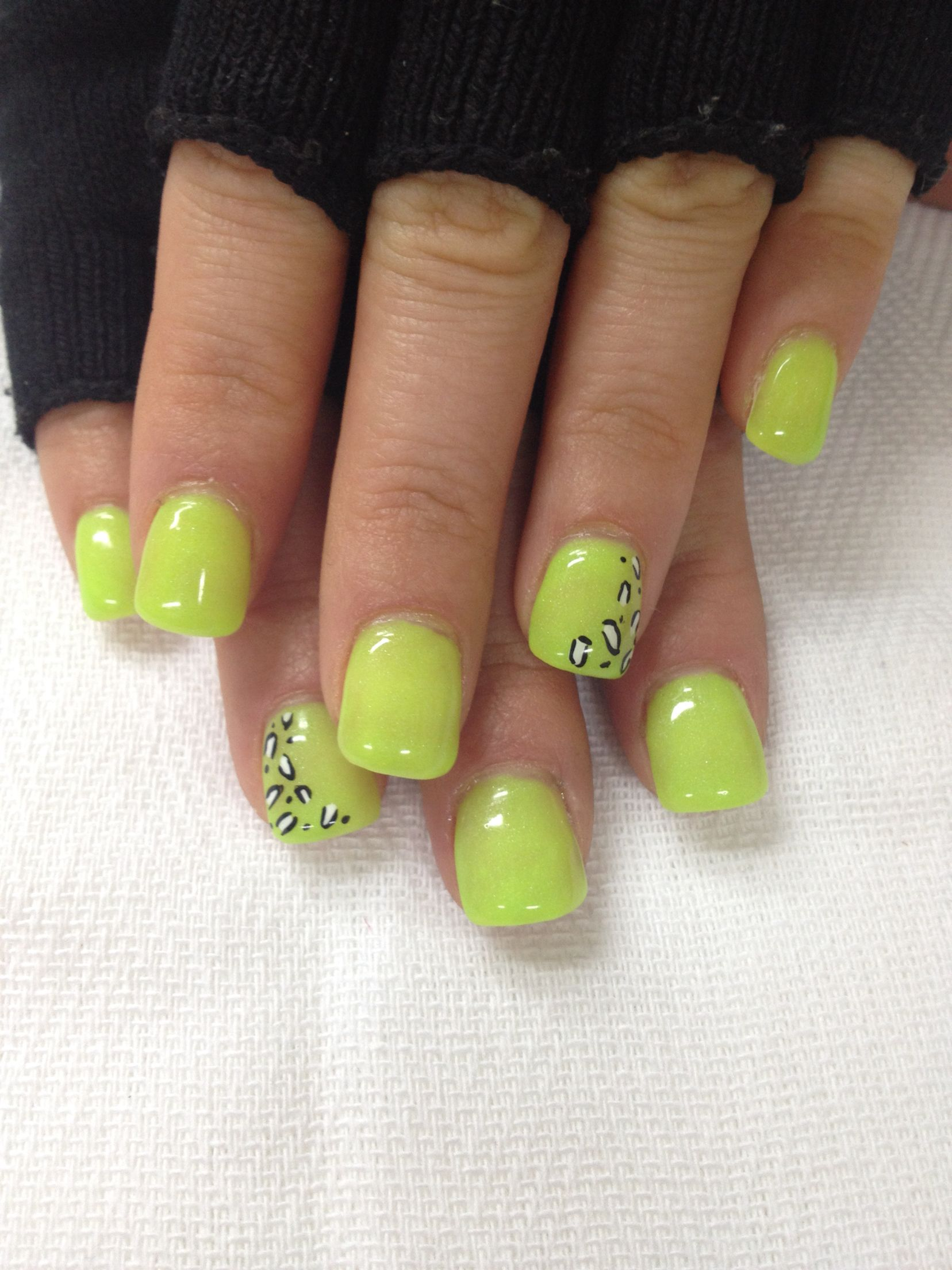 Neon yellow green gel nails with leopard accents. All done with ...