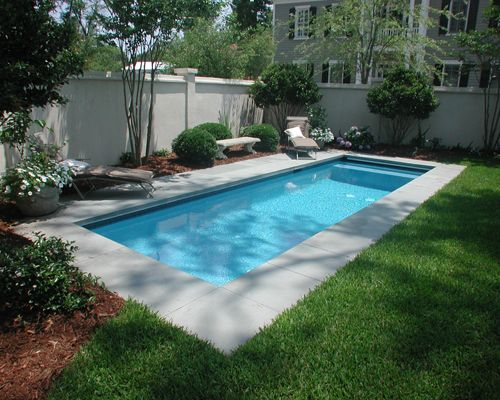 Rectangle Pool great example of a courtyard swimming pool design! this pool also
