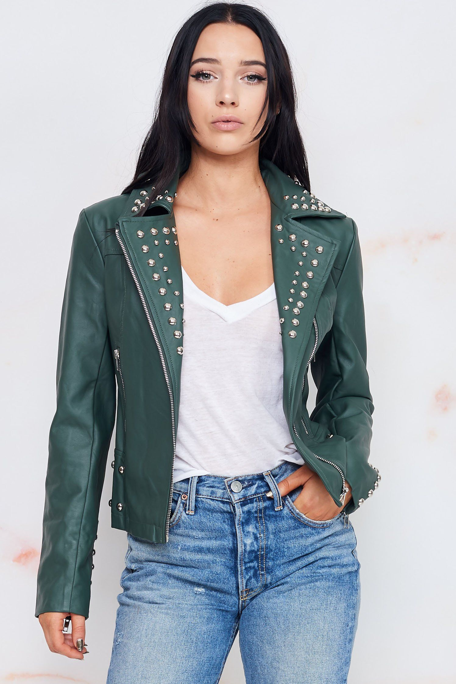 , A faux leather moto jacket embellished with round studs