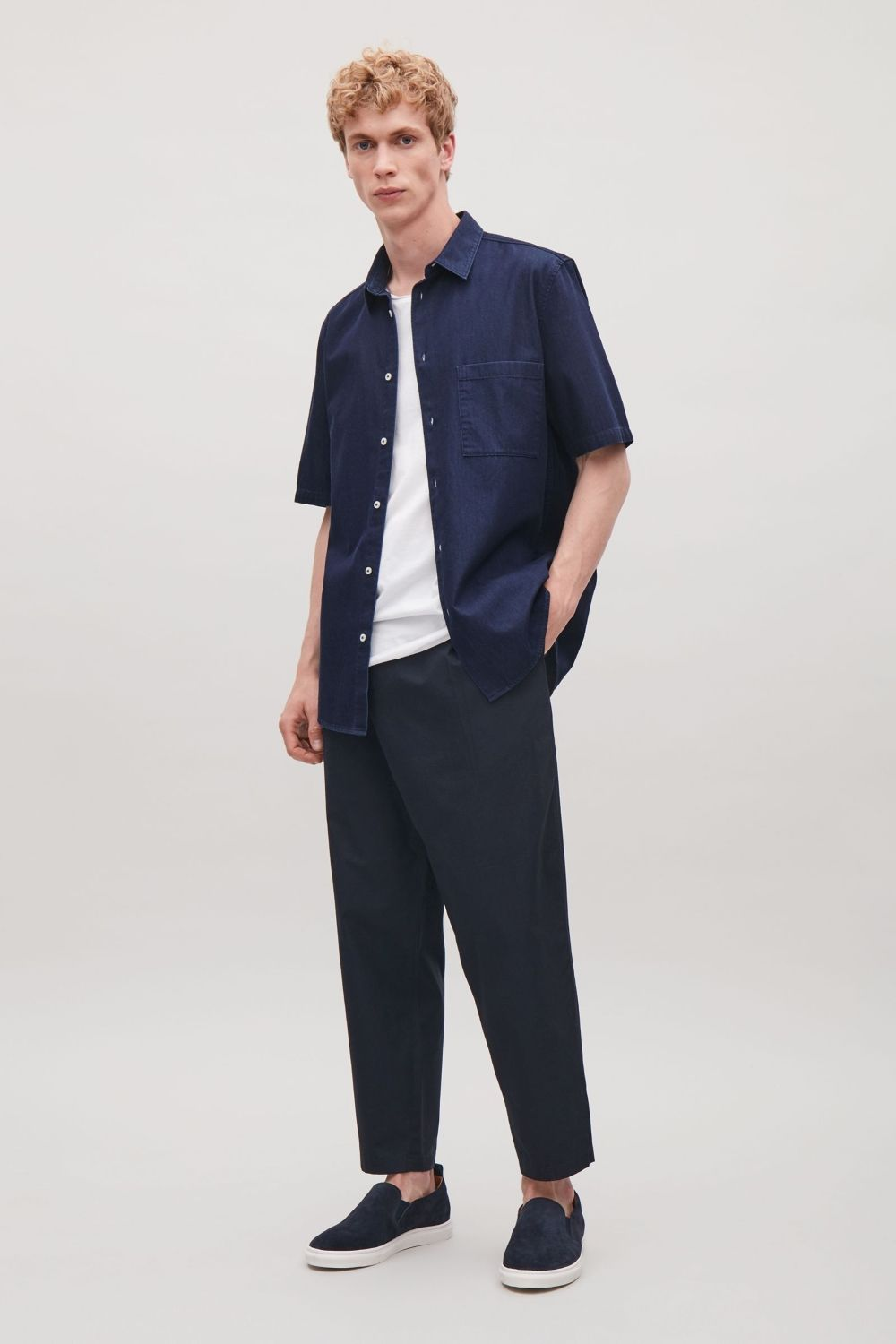 This casual shirt is made from a dark washed denim with a pointed