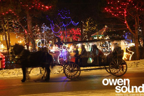 Horse-drawn carriage through downtown Owen Sound touring the Festival of Northern Lights.