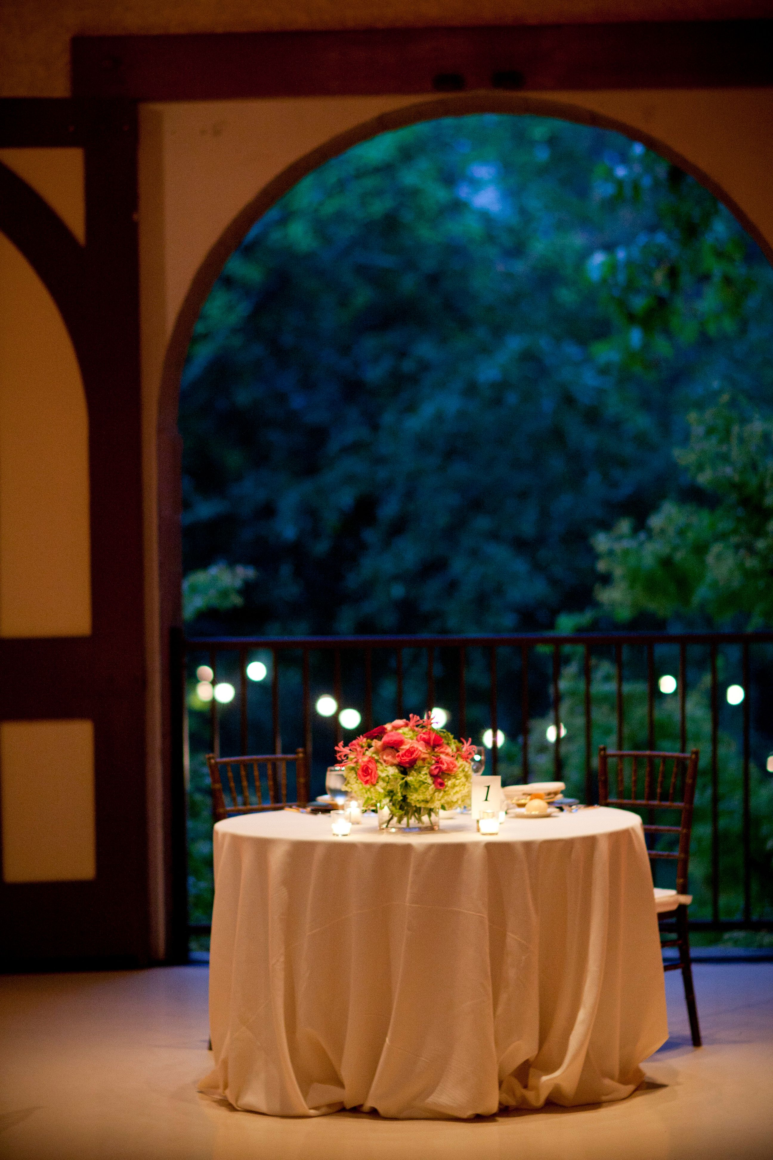 Sweetheart table / low arrangement with pearlized votives