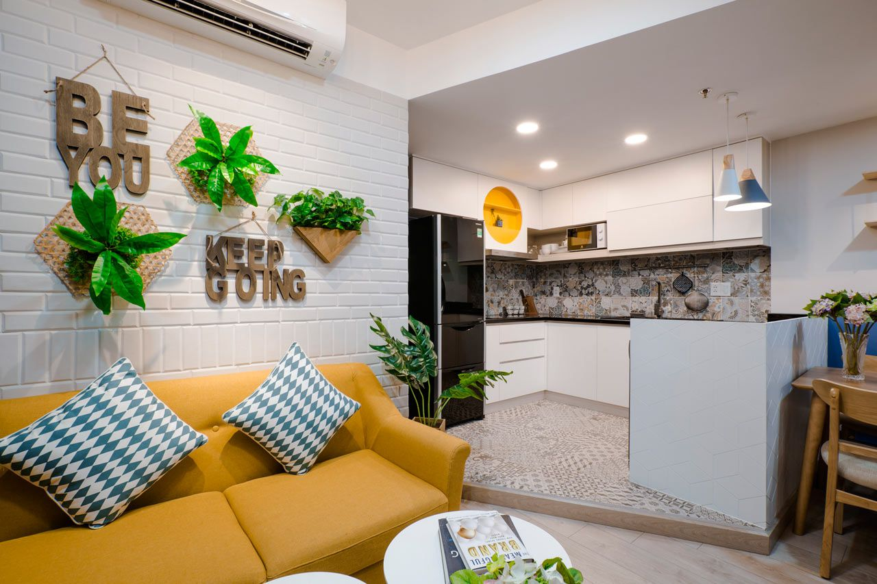 Toki home transforms an apartment in vietnam with color interior