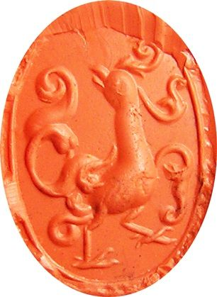 Impression of an ancient Greek rock crystal intaglio, dating to the 5th - 4th century B.C. That I believe to be an early representation of a phoenix, depicted in the moment of it's death and resurrection. The large domed intaglio is finely cut, with an image of a bird like creature, surrounded by magical fire swirls. The intaglio has a linear border, similar to that found on ancient scaraboid seals from Egypt, Etruria and Phoenicia.This exquisite piece of ancient art, is beautifully