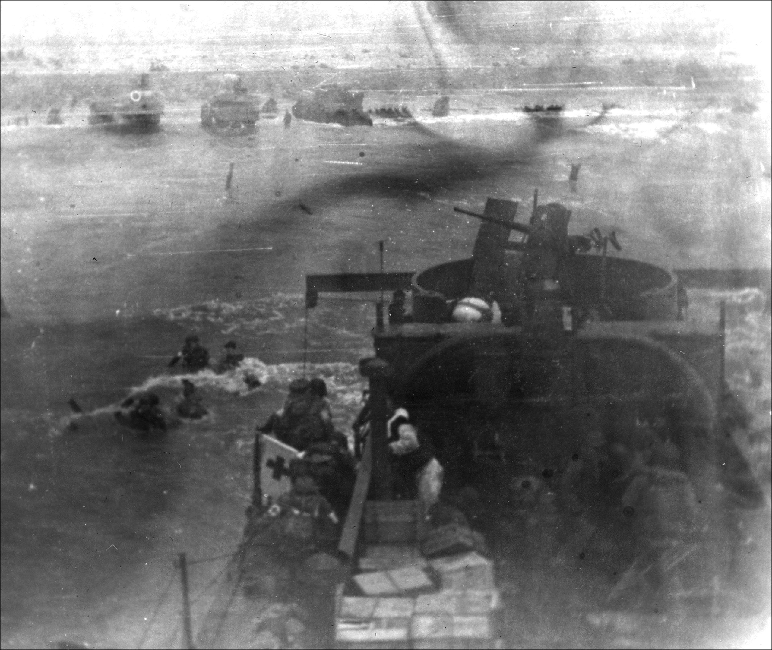 LCI 94, Omaha Beach. A medical detachment from the 3rd Battalion, 116th Infantry Regiment, 29th Infantry Division lands at Dog Red, Omaha Beach.
