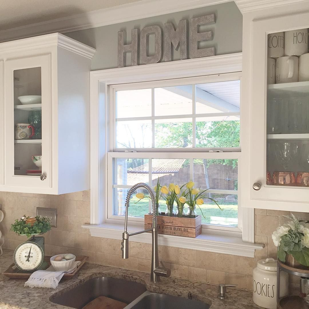 I like the raised window and the glass cabinets around it for Kitchen ideas no window