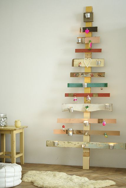 """Recycled wood """"xmas"""" tree (love the little tins on their for candles)."""