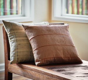 Raw Silk Pillow covers in neutral colors. Made by skilled artisans in Cambodia who use the fair pay they receive to give back to their communities.
