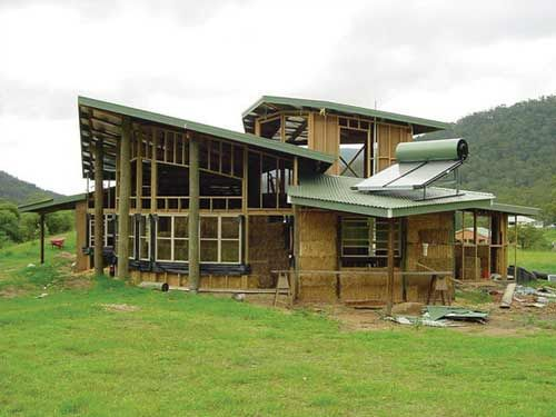 Another, fancier Straw Bale House (still under construction ... on hay bale homes plans, straw homes design, straw bale homes, straw bale prices, straw building,