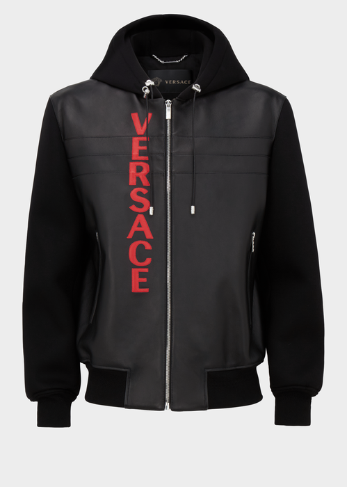 3ca31ba4cd64 Versace Logo Hooded Bomber from Versace Men s Collection. Bomber jacket  with Versace leather logo lettering features front zip closure