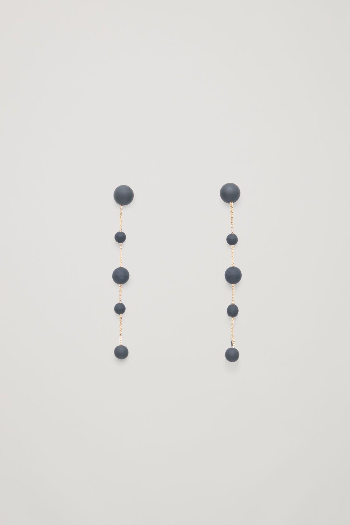 prezzo all'ingrosso sempre popolare eccezionale gamma di stili Front image of Cos beaded chain earrings in gold | accessory