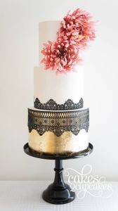 simple white and black lace wedding dress with pink flowers