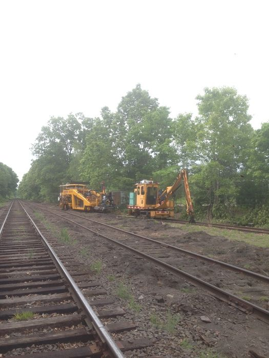 Track work continues at Medfield Junction. A tie crane and a tamper occupy the end of the former Bay colony Newton line at Medfield junction. Photo by Steve Hurley, May 3, 2016.