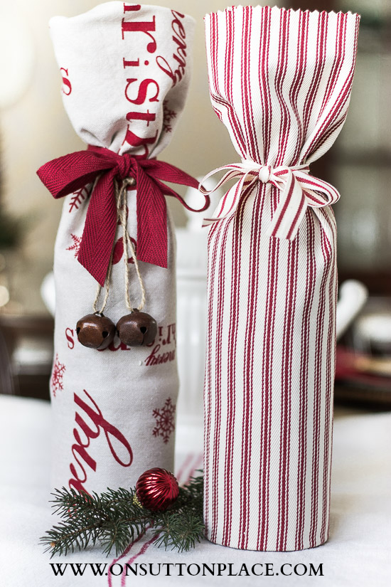 Hostess Gift Ideas: wrap a wine bottle in a festive tea towel. This post  has the link that shows you how to fold the towel. - Hostess Gift Ideas CrAfTy 2 ThE CoRe~DIY GaLoRe Gifts, Hostess