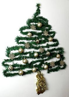 Need a fun Christmas tree to decorate your small space? Hate the mess of a live tree? Try this sparkling Christmas tree on the wall courtesy of Gorgeous in Grey. All you need is garland and ornaments!