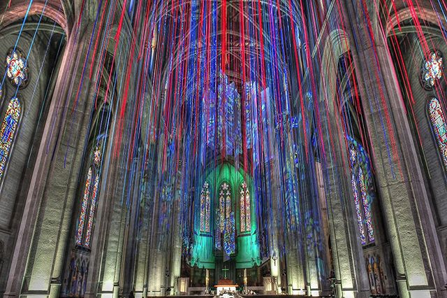 Grace Cathedral in San Francisco, Anne Patterson has created Graced With Light, installation that features nearly 20 miles of multicolored ribbons cascading from the church's vaulted ceiling arches