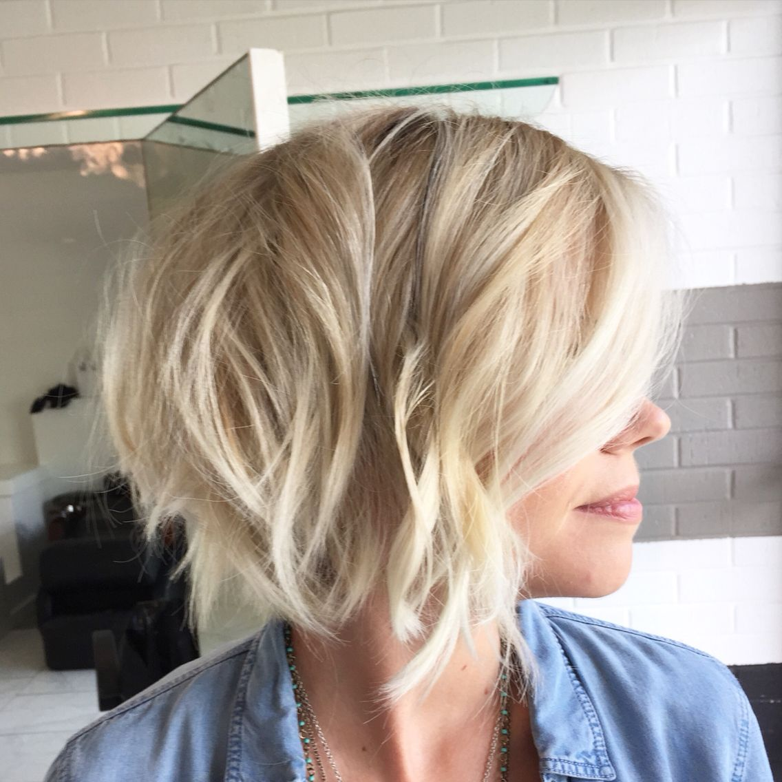 Short hair cut textured bob blonde hair low maintenance hair color