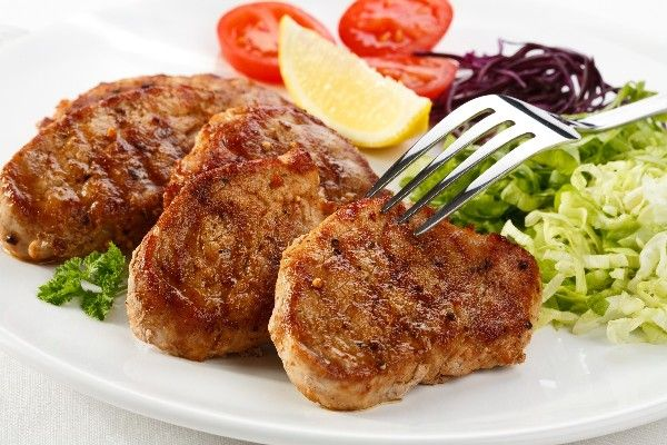 Recipe including course(s): Entrée; and ingredients: black pepper, garlic, ground cumin, lime, olive oil, onion powder, pork chops
