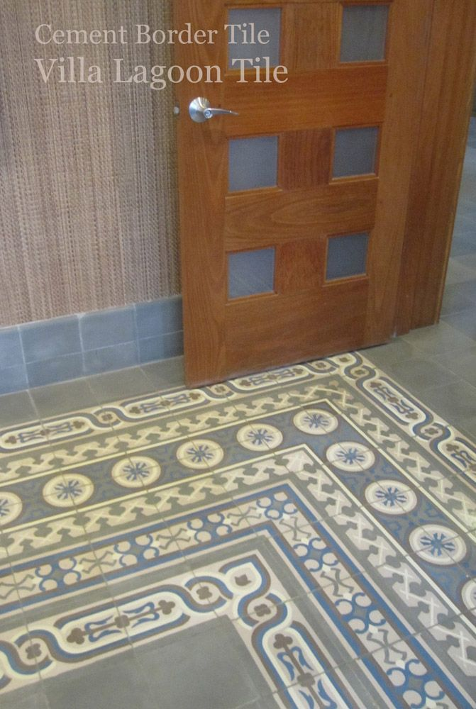 A very deep encaustic cement tile border at the corner of a room ...