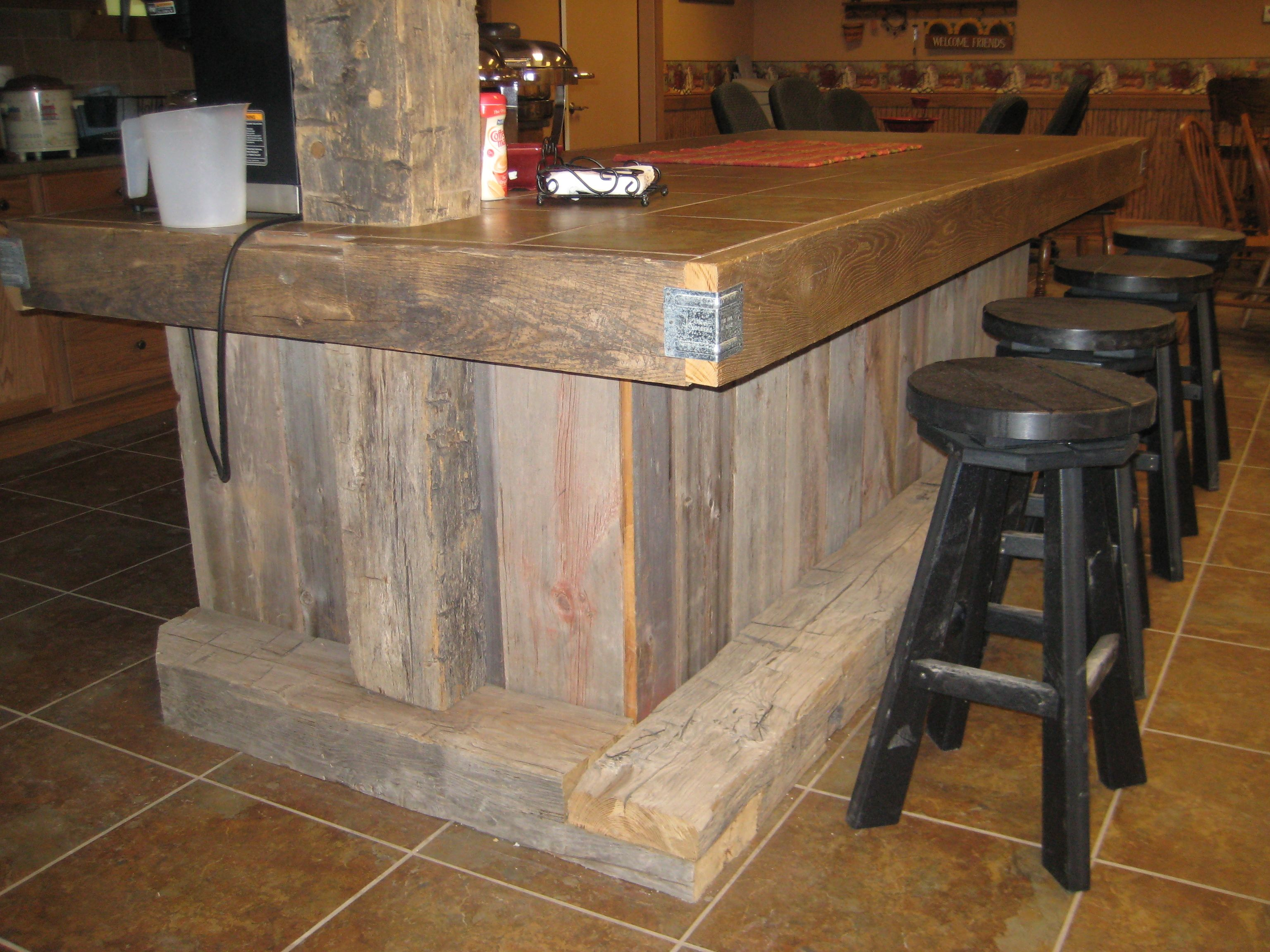 a great way to incorporate barnwood into a kitchen island. the tile