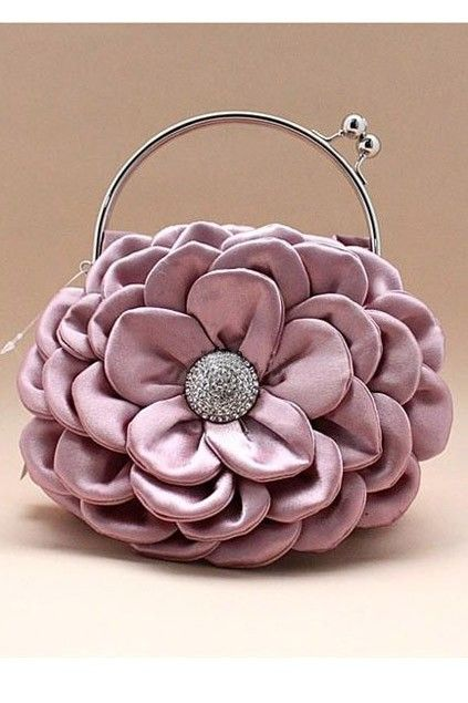 The handbag crafted in silk, featuring exqusite flower pattern, round twin metal grab handles with twist lock. Elegant and Luxurious!