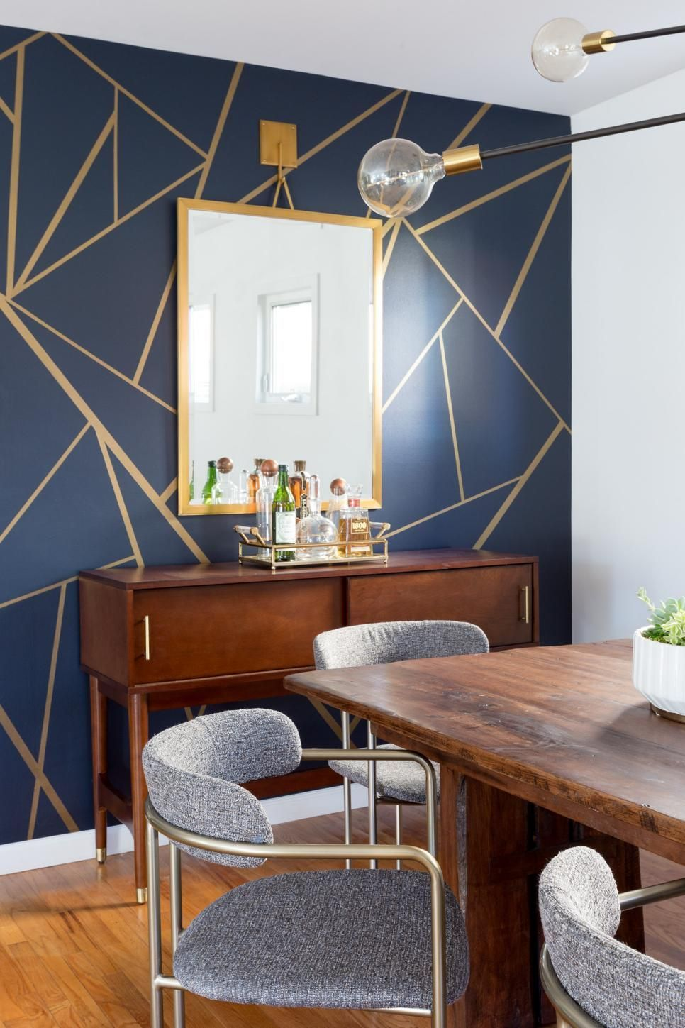 Eclectic Dining Room with Navy and Gold Wallpaper Accent