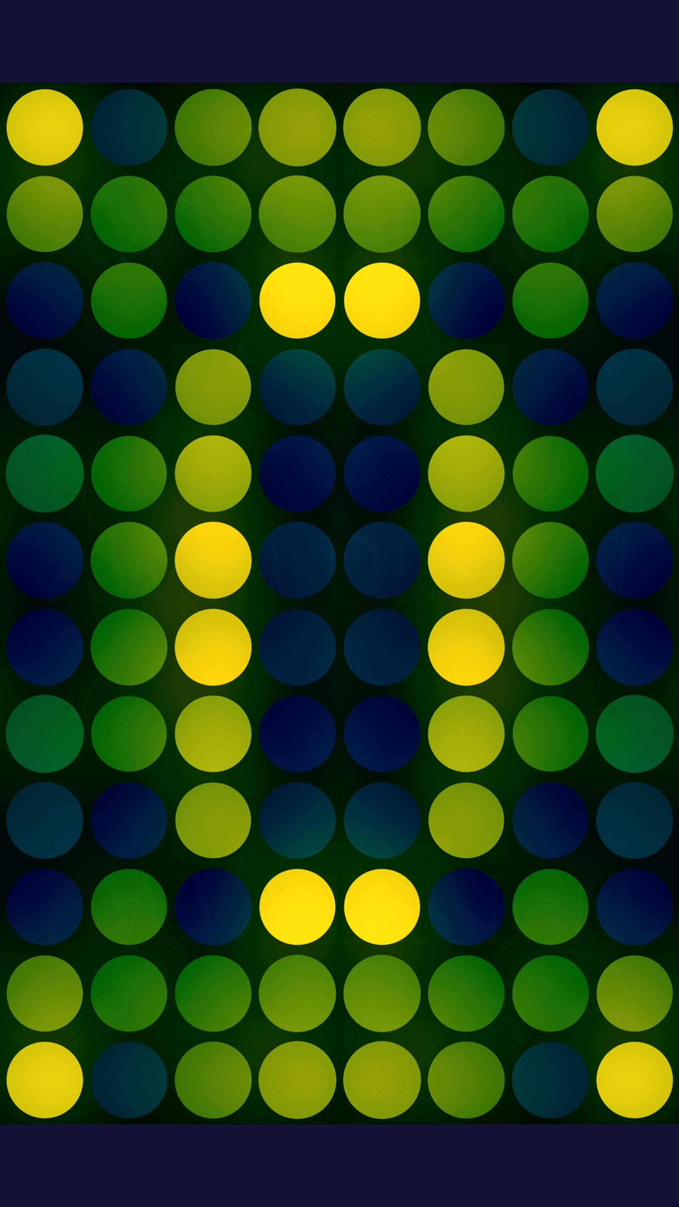 The glowing green-yellow mosaic of circles on a dark blue background.