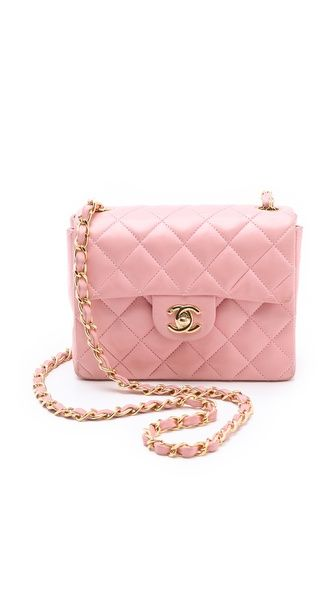 WGACA Vintage Vintage Chanel Mini Bag.  Compact and convenient, this authentic vintage Chanel bag is just the right size for a smartphone and a few modern essentials. Diamond quilting and a logo turn-lock. The long chain strap completes the classic silhouette. Lined interior with 3 pockets. Dust bag included.