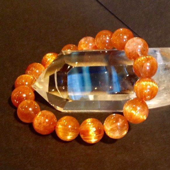 最高品質のオレンジキャッツアイ ルチルの10ミリブレスレット✨|ハンドメイド、手作り、手仕事品の通販・販売・購入ならCreema。
