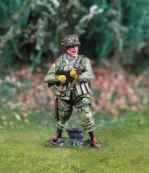 World War II U.S. 101st Airborne CS00738 Firing Thompson Machine Gun - Made by The Collectors Showcase Military Miniatures and Models. Factory made, hand assembled, painted and boxed in a padded decorative box. Excellent gift for the enthusiast.