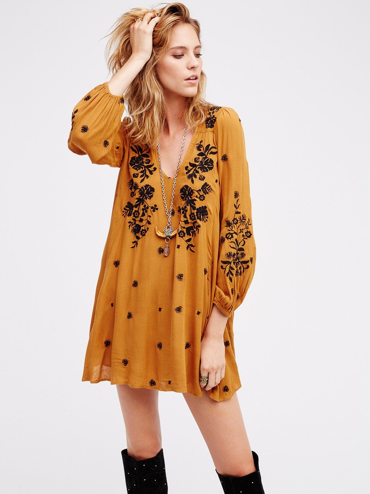 Sweet Tennessee Mini Dress | Flowy swing dress with an allover beautiful embroidered design and V-neckline. Elastic band at the back bust and cuffs with a cutout opening in back. Lined.