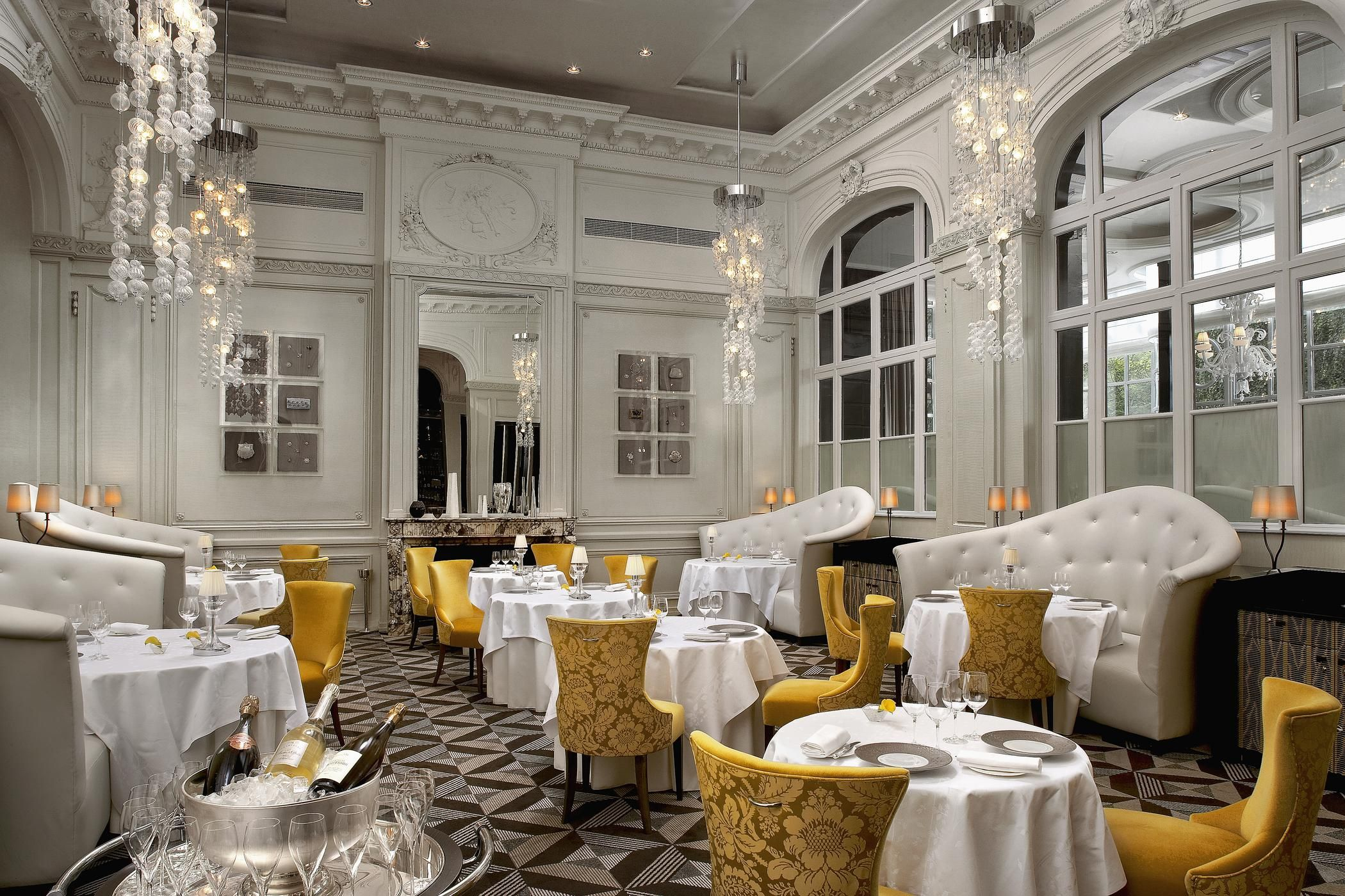 Gordon Ramsay S Trianon Palace Versailles Restaurant Is Decorated With Elegant White Molding And Bold Yellow Chairs