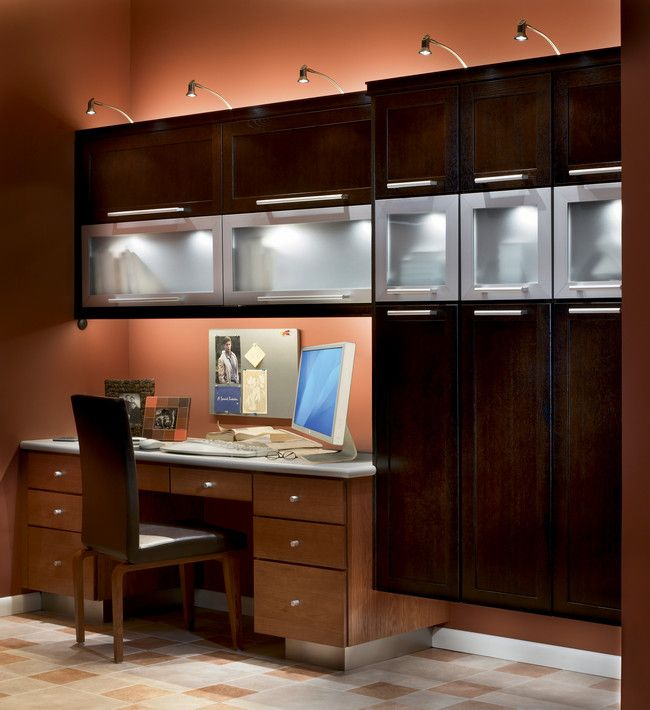 Combine A Custom Desk In Light Toffee With Overhead Cabinets Dark Quartersawn Oak Peppercorn Frosted Gl And Aluminum Accents