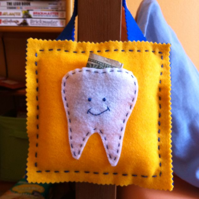 The tooth pillow I made Tau. Based on a similar one by Martha, 'cept mine hangs on the bedpost so the tooth fairy can't possibly miss it!