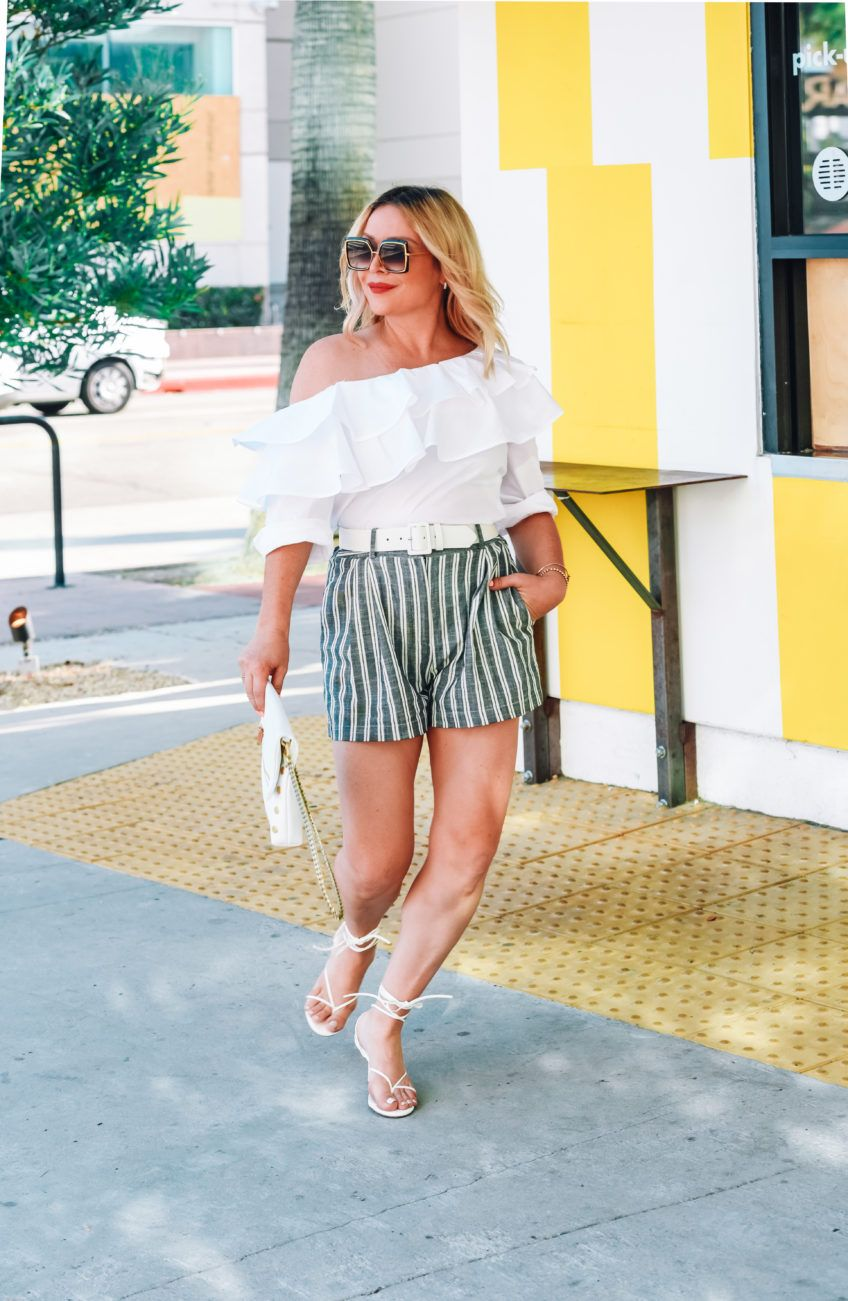 Striped Shorts Ruffle Top Strappy Sandals The Hunter Collector Summer Outfits Women Fashion Fashion Week Street Style [ 1301 x 848 Pixel ]