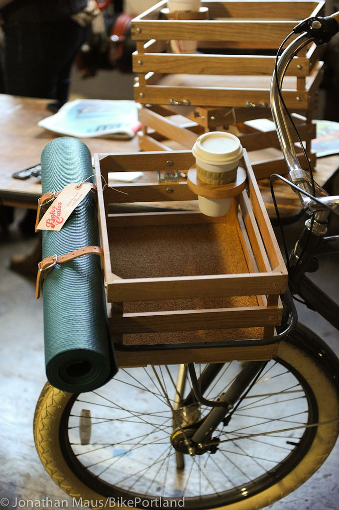 Bike basket with a cup holder and straps for your yoga mat or picnic blanket.