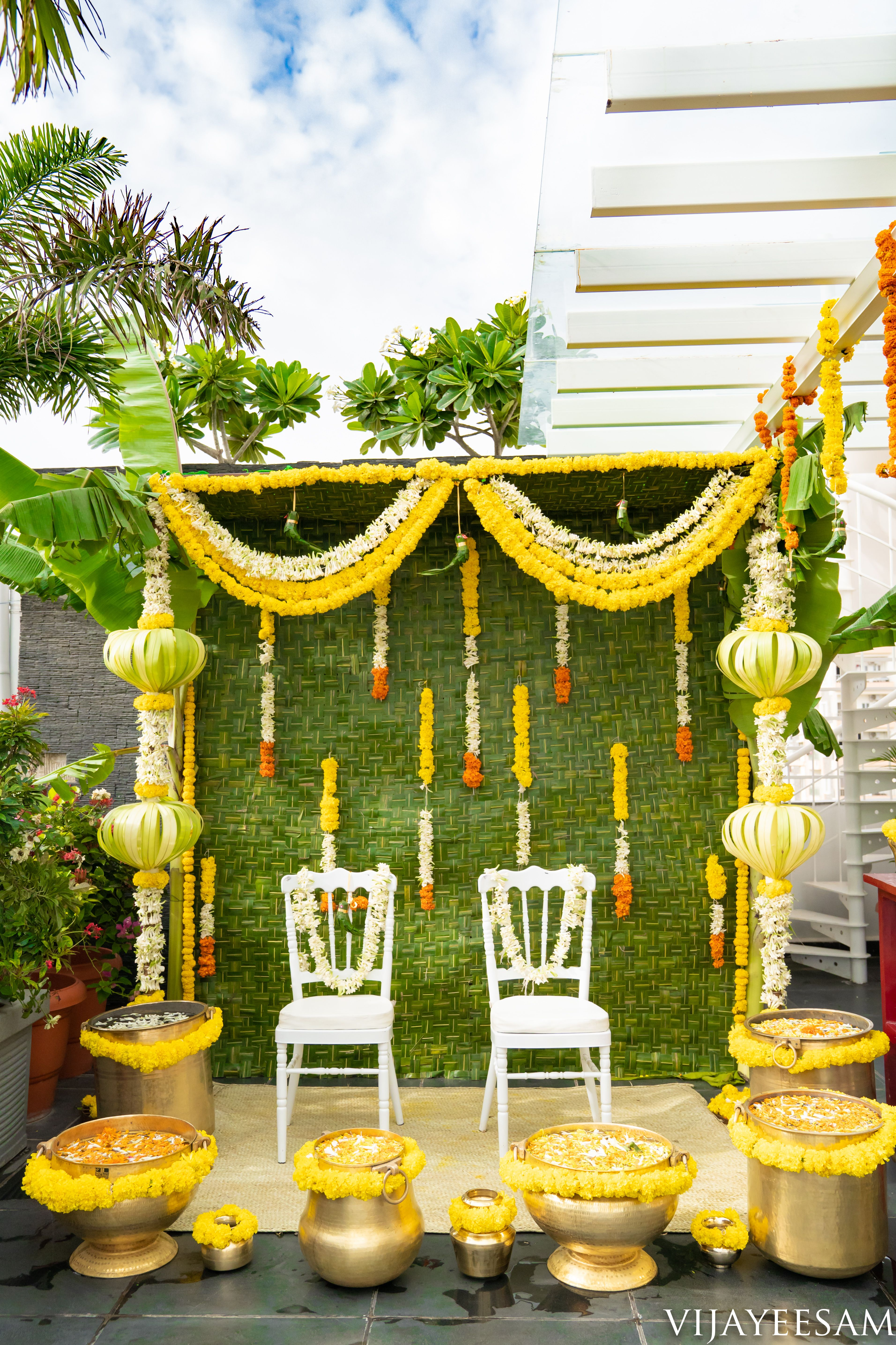 Green leaf based decor with abstract pillaiyar in white