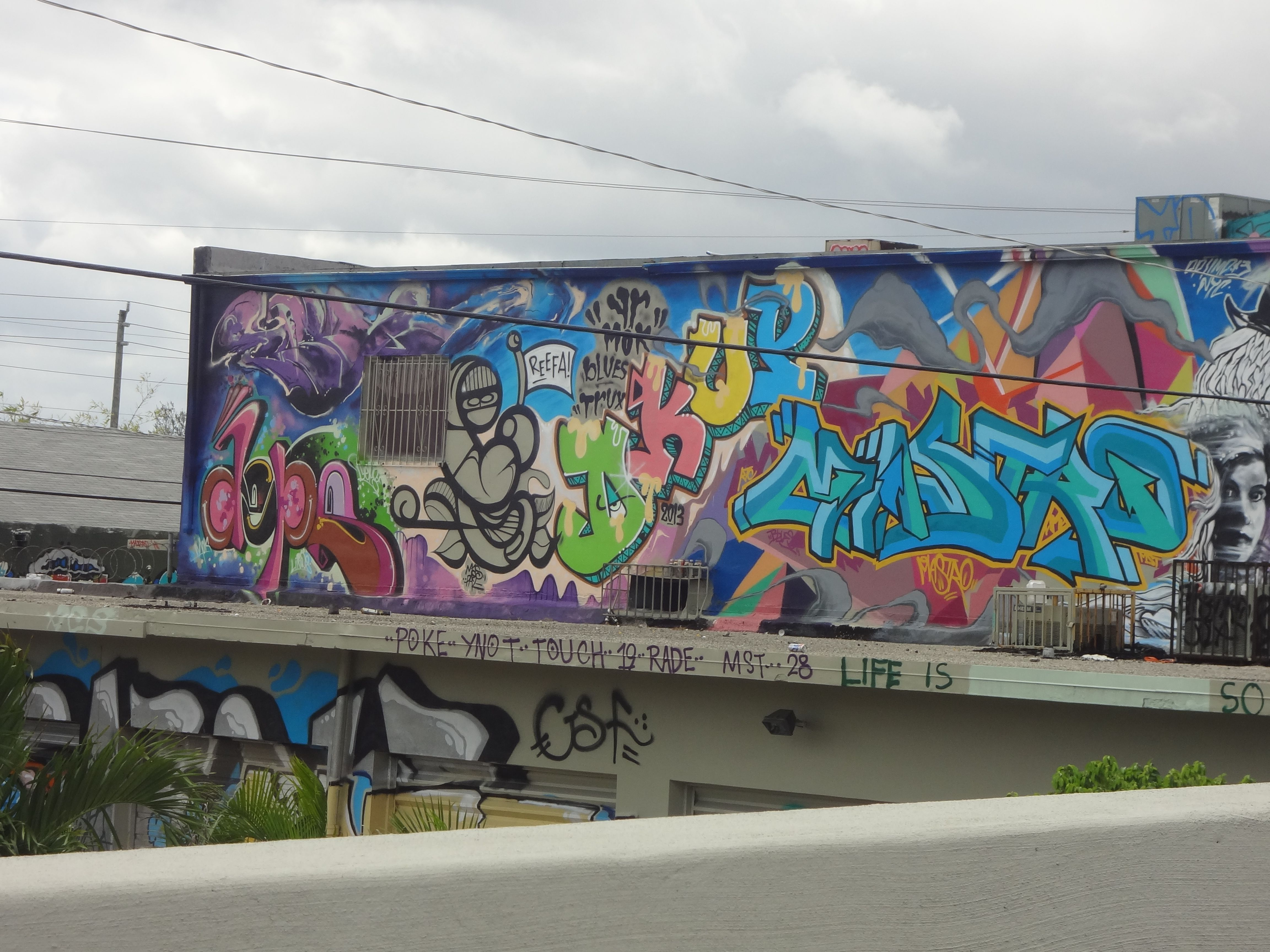 Diverse graffiti as seen from the i 395 n miami ave exit near the shops at midtown