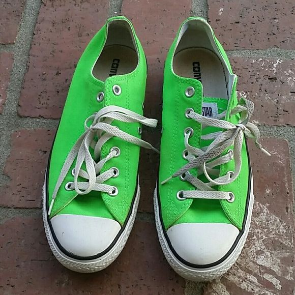 Neon green Converse Gently used, no rips, tears, or stains. I haven't put them in the washing machine but you can if you want them even cleaner than they already are Converse Shoes Sneakers