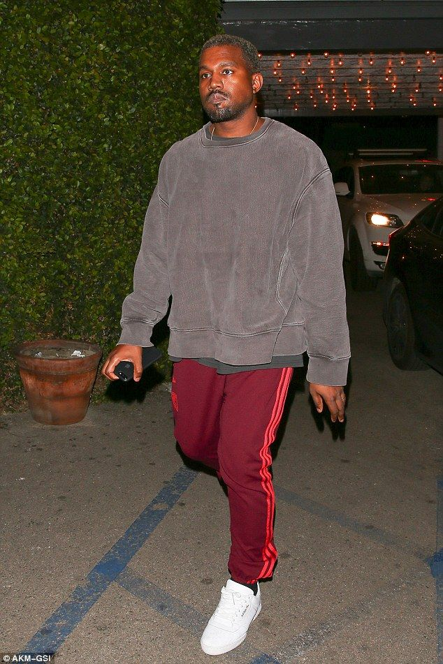 3e6ca68f0be02 Kanye West appeared in glum spirits as he left dinner with pals in LA on  Monday night