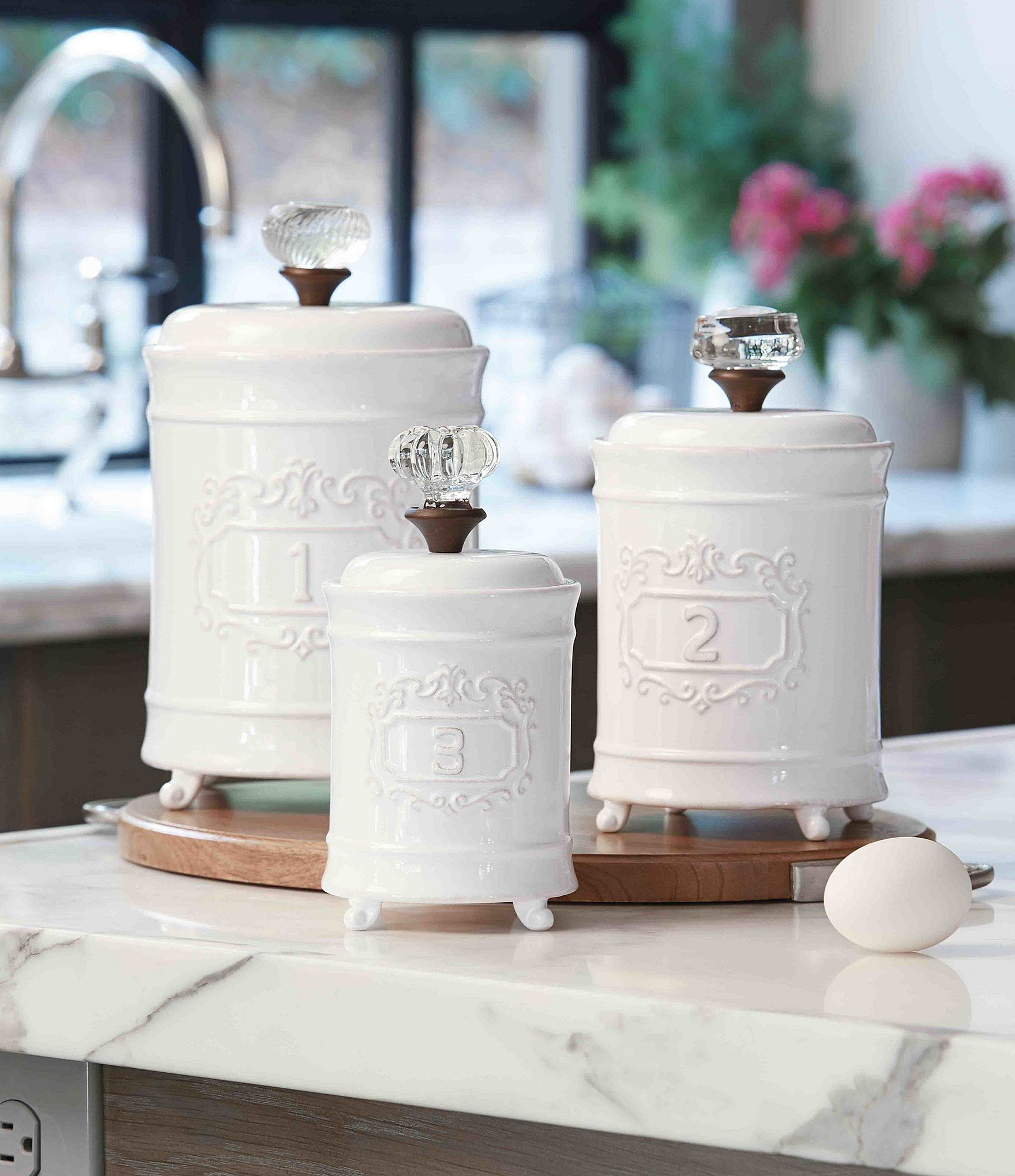 Mud Pie 3Piece Farmhouse Circa Vintage Doorknob Canister Set is part of White Home Accessories Country Kitchens - From the Circa collection by Mud Pie, these canisters featurelids with vintagestyle glass doorknob handlesembossed 1, 2 and 3 identifiersfooted basesmall approx  7 5double;medium approx  9 x 5double;large approx  10 x 6double;ceramichand washImported