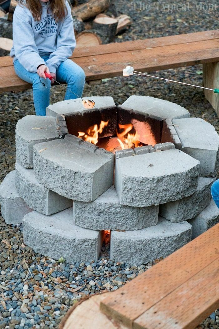 How we made a fire pit + 2 benches for just $100 plus other do it yourself cheap fire pit ideas your family can make and enjoy in your backyard. #diy #firepit #backyard #ideas #doityourself #diyfirepit