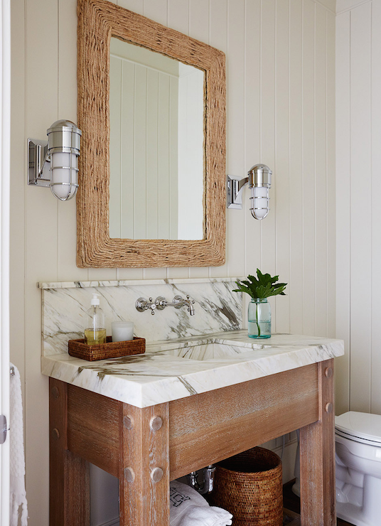 Amazing Bathroom With White Beadboard Walls Framing Rectangular Driftwood Mirror Flanked By