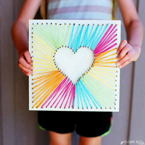 If you've never tried string art before, there's no better reason to start than surprising Mom with this beautiful craft on Mother's Day.  Get the tutorial at Sugar Bee Crafts.