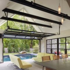 Convert the garage into an outdoor kitchen use a glass overhead