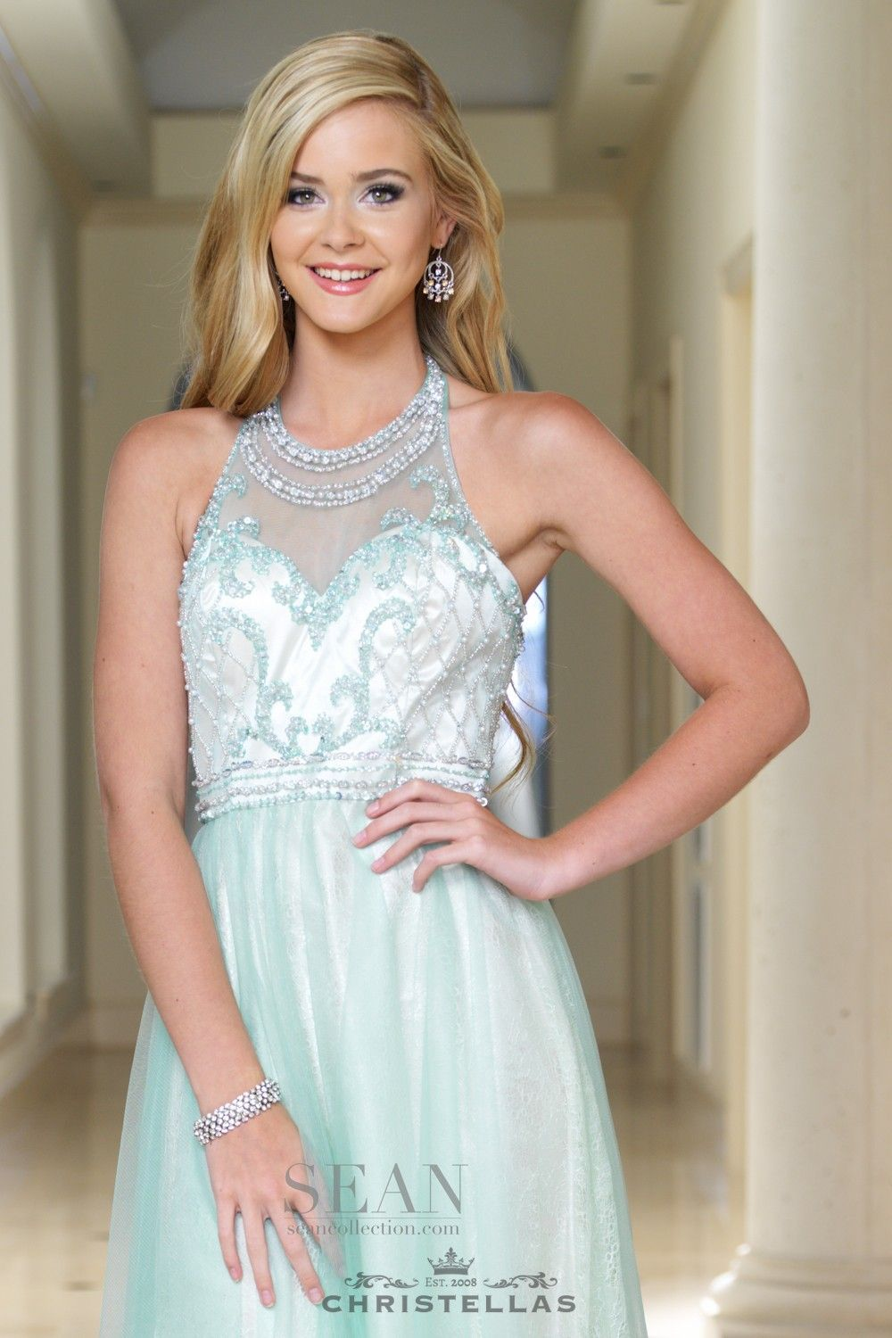 Look majestic in mint with this glittering illusion halter dress