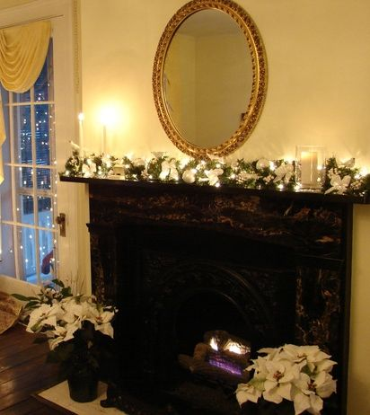 Christmas fireplace with red poinsettias instead