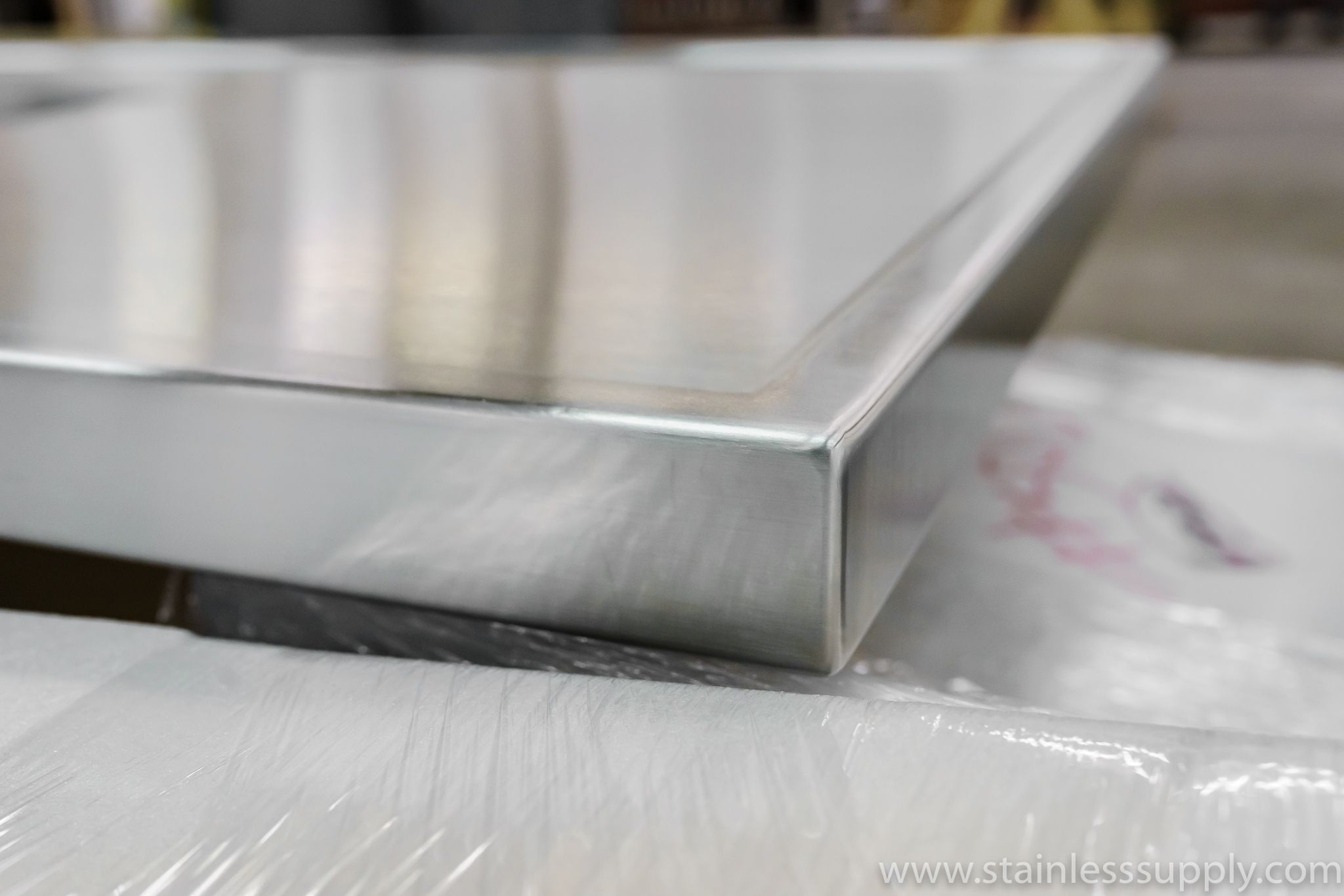A Closeup Of The Corner Of A Stainless Countertop With A Marine