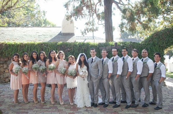 Bridesmaids 1) choose a dress that they absolutely loved and would wear again, and 2) choose a color in the blush-tone-peach color family. Groomsmen wore gray vests and slacks, paired with a crisp white shirt.