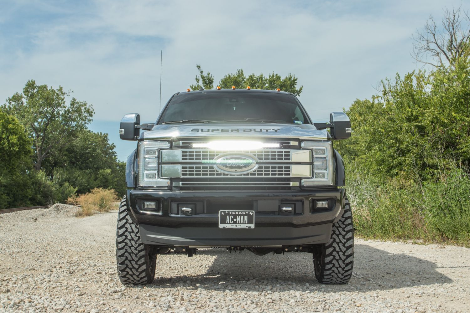 Custom Led Light Bar In Super Duty Platinum Grill On A Lifted 4x4 Truck Built By Rad Rides In Garland Texas Light Bar Truck Ford Super Duty Trucks Bar Lighting